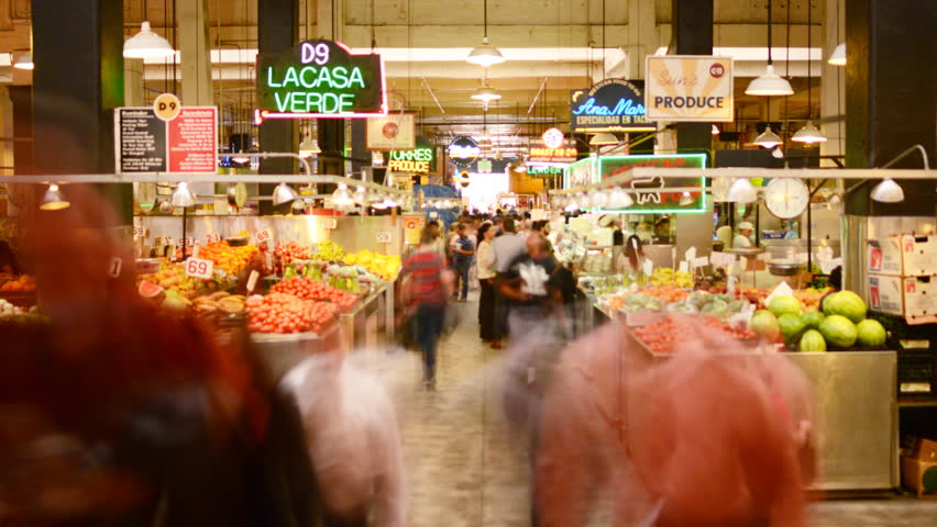LOS ANGELES, California - April 9th: 4K Time lapse Photography with zoom out  motion of unrecognizable shoppers gather at historic Grand Central Market in Downtown Los Angeles on April 9th.
