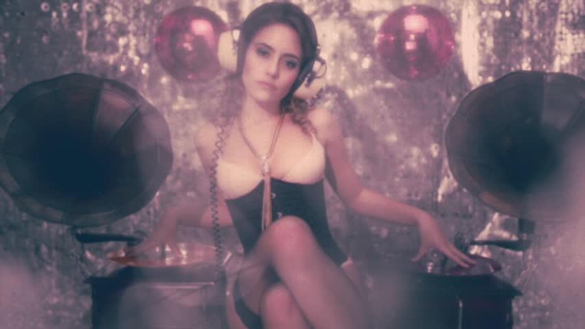 fantastic clip of sexy female DJ in lingerie with vintage gramophones. useful for parties, events and disco