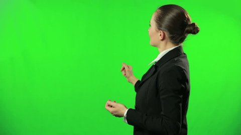 Female weathercaster giving weather report against a green screen
