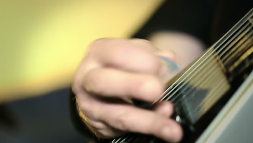 Guitarist plays, close up