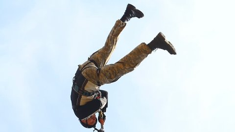 a man jumping off a Pashkovsky bridge (30 m) on the outskirts of Krasnodar during the ropejumpers club's open training - jump shooting is conducted from a distance