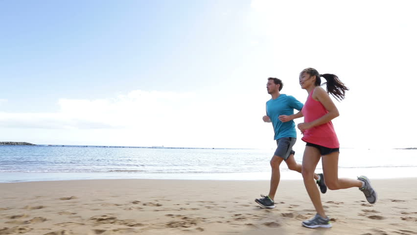 abd696813704c Runners running on beach. Jogging couple training on beach in full body  length living healthy active lifestyle. Asian runner woman and fit male  fitness ...