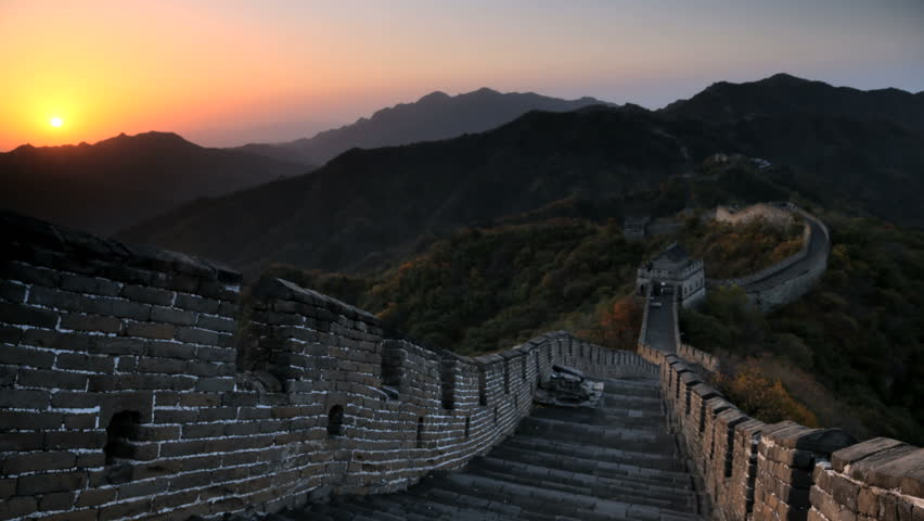 Time lapse view sun rising over Great Wall of China stone fortifications, Mutianyu nr Beijing, Mainland China, East Asia