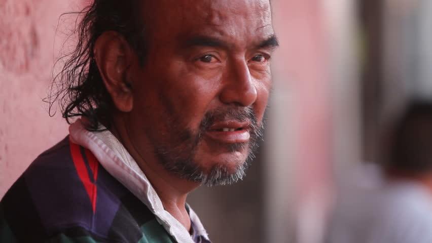 ANTIGUA GUATEMALA,GUATEMALA, MARCH 2012:Expressive closeup of mad man. Man looking at the camera, mad eyes. Sequence, close-up, medium shot