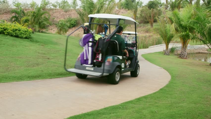 People, sports, leisure activities, recreation and lifestyle, group of friends driving golf cart in country club during summer holiday. Man and woman on vehicle, 27of30