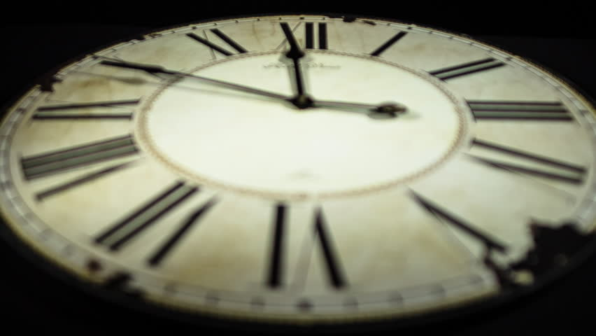 clock with roman numerals  time lapse shallow deep of field