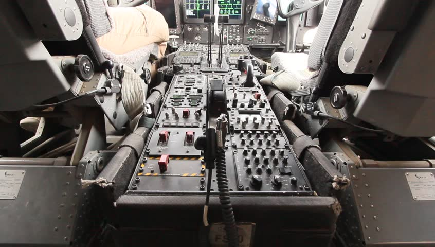 Afghanistan, Circa 2011: Tilt up shot of avionics and USAF airman in cockpit of Hercules c-130 military aircraft in Afghanistan, Circa 2011