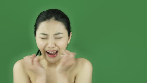 Asian girl naked beauty young adult isolated greenscreen green background scared screaming