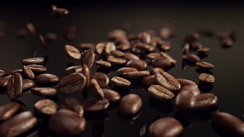 Coffee beans flight. High quality slow motion coffee beans flight. Best for your commercial movie or presentation.