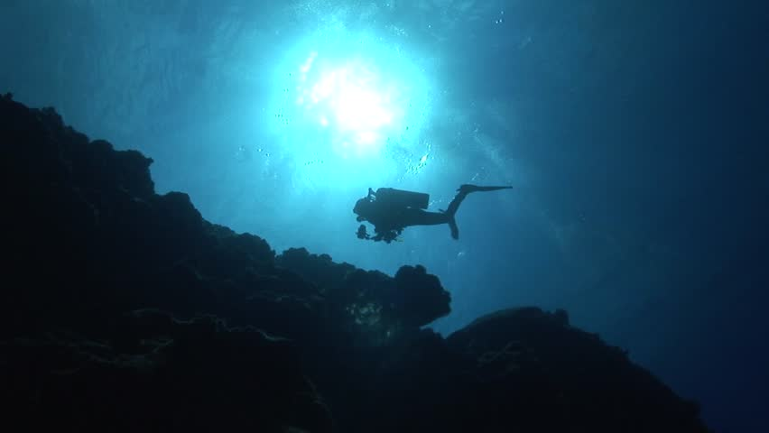 Divers in backlight in crystal clear water | Shutterstock HD Video #6271697