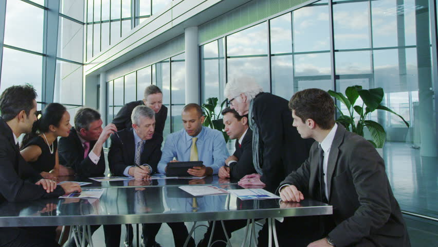 Cheerful diverse business group with a tablet computer in a business meeting | Shutterstock HD Video #6284492
