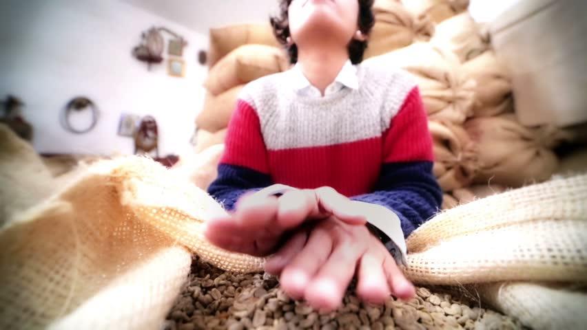 Hispanic woman smells green coffee beans