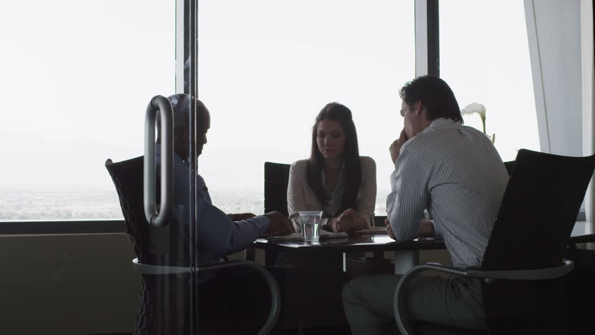 Medium Shot Business people having meeting in conference room