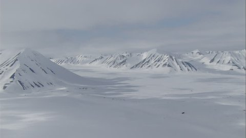 Aerial Footage Arctic Tundra . Stunning aerial footage of the vast and desolate arctic tundra. Steep mountain ranges cover the terrain.