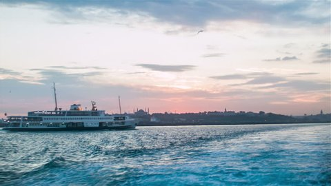 Ferry Floating Away At Bosphorus At Evening Time