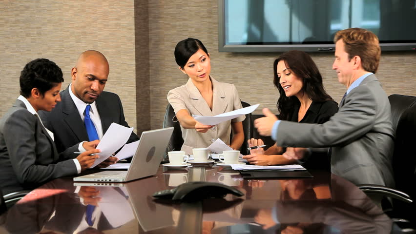 Video montage Multi ethnic business partners closing finance deal - CG montage video images of Multi ethnic male and female business partners closing finance deal text background | Shutterstock HD Video #6400412
