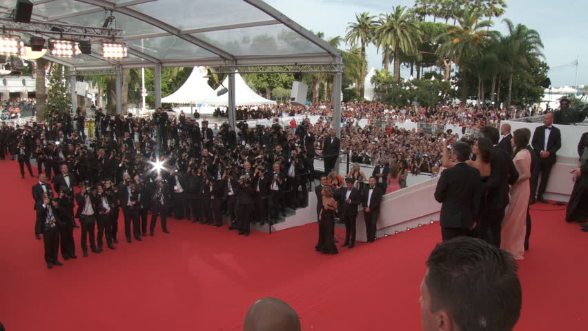 """CANNES, FRANCE - MAY 2014: Pan of cast of """"The Search"""" on the steps of the red carpet for the premiere of their film at the 67th Cannes Film Festival."""