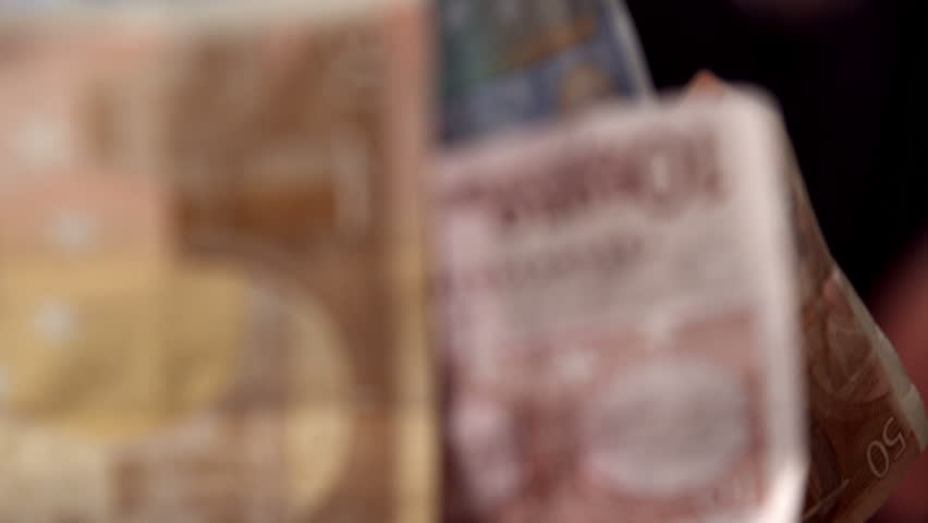 Person throwing money at the camera in slow motion | Shutterstock HD Video #6432671