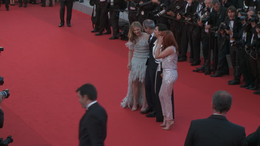 """CANNES, FRANCE - MAY 2014: Kristen Stewart, Chloe Grace Moretz, Juliette Binoche and Olivier Assayas walk the red carpet for the premiere of """"Sils Maria"""" at the 67th Cannes Film Festival."""