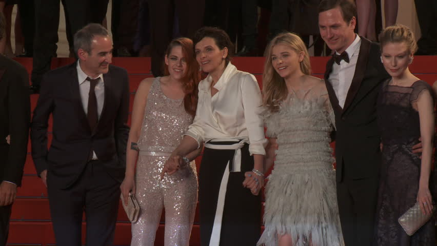 """CANNES, FRANCE - MAY 2014: Kristen Stewart, Chloe Grace Moretz, Juliette Binoche and Olivier Assayas on the red carpet after the premiere of """"Sils Maria"""" at the 67th Cannes Film Festival."""