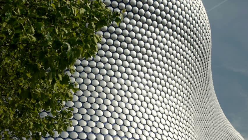 Detail of modernist department store exterior in Birmingham, England. Clad in alumnium discs, the exterior of Selfridges in Birmingham.