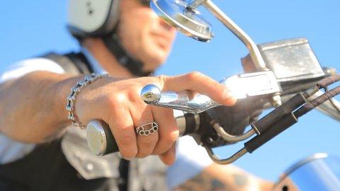 biker starting for a ride accelerates handlebar