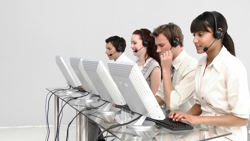 Multi-ethnic business people working in a call center with headset on
