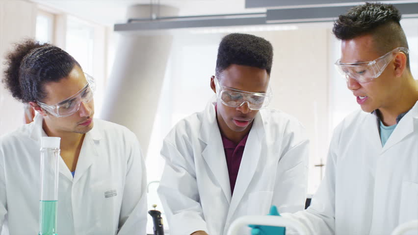 Young group of university students working together in science class | Shutterstock HD Video #6557642