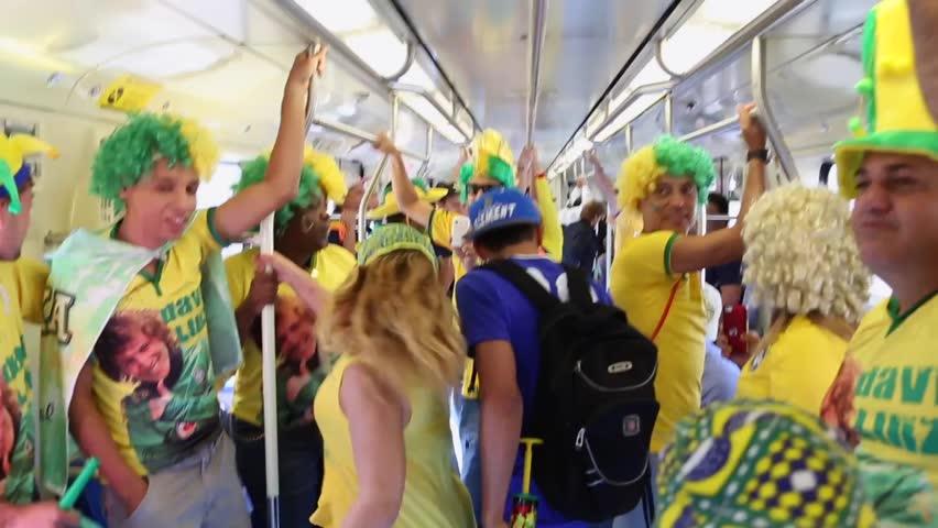 SAO PAULO, BRAZIL - CIRCA JUNE 2014: Brazilians Fans sing in subway
