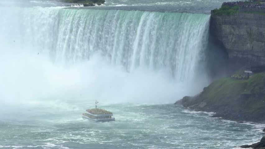 NIAGARA FALLS, CANADA - Circa, June, 2014 - Tourists aboard the riverboat, Hornblower, approach the Horseshoe Falls at Niagara Falls.