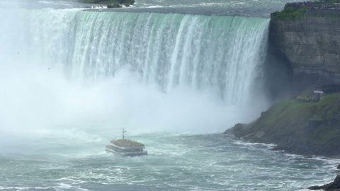 NIAGARA FALLS, CANADA - Circa, June, 2014 - Tourists aboard the riverboat, Hornblower, approach the Horseshoe Falls at Niagara Falls.