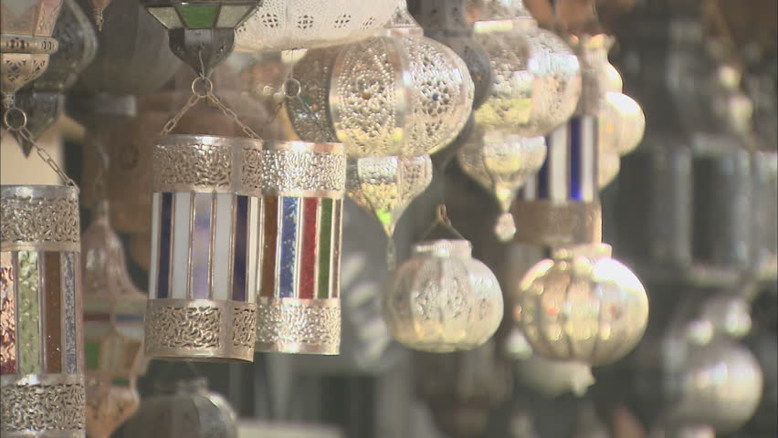 A row of traditional silver lanterns hanging in a Moroccan market stall, with a defocus, Marrakech, 2013