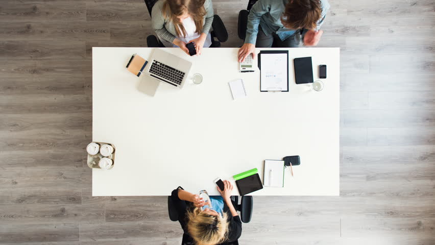 Diverse group of people aerial view timelapse creative business meeting planning thinking ahead startup company | Shutterstock HD Video #6604370