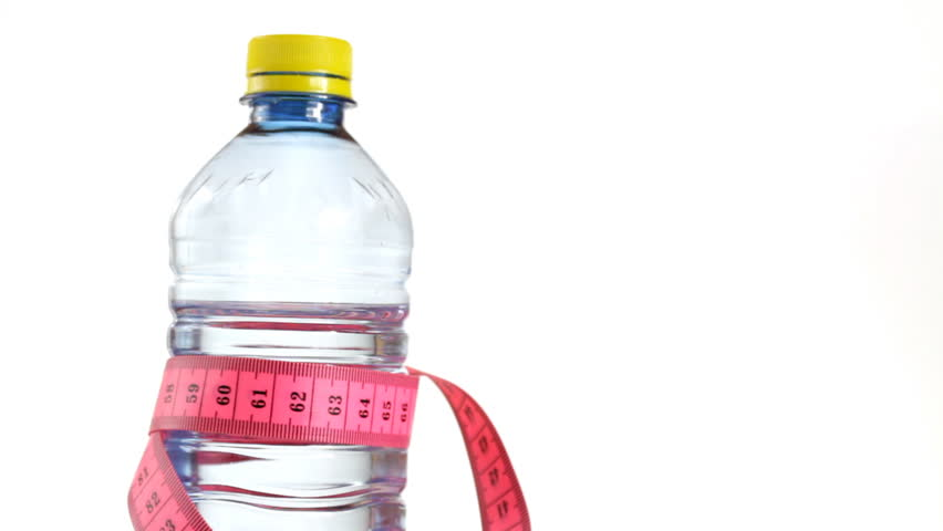 Tape measure wrapped around bottle of water, loopable - 1080p