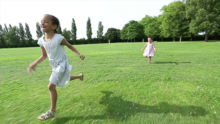 b83ff7a48897 Two Young Girls Running Along Stock Footage Video (100% Royalty ...