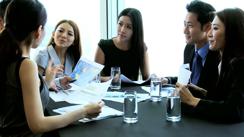 Ambitious young male female Asian Chinese business team discussing ideas future contract bidding brainstorming modern conference room | Shutterstock HD Video #6643832