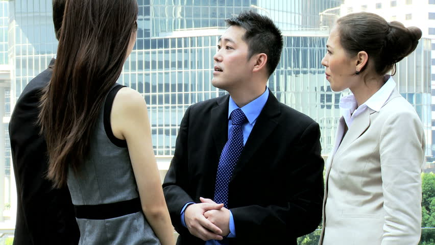 Ambitious male female Asian Chinese Caucasian corporate business colleagues discussing future plans downtown modern city | Shutterstock HD Video #6646712
