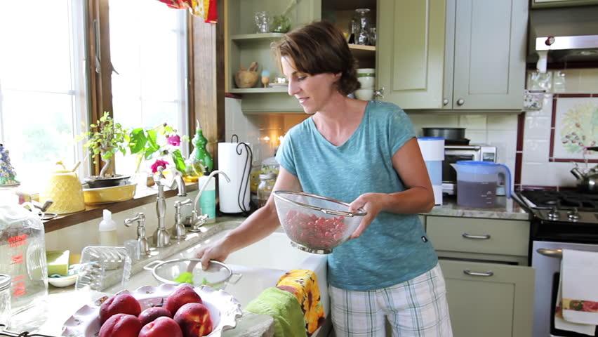 Woman Prepares lunch in her farm house kitchen   Shutterstock HD Video #6655982