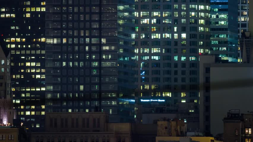 4K. Windows of office buildings illuminated at night in downtown Los Angeles city. Pan up. Timelapse. | Shutterstock HD Video #6662879