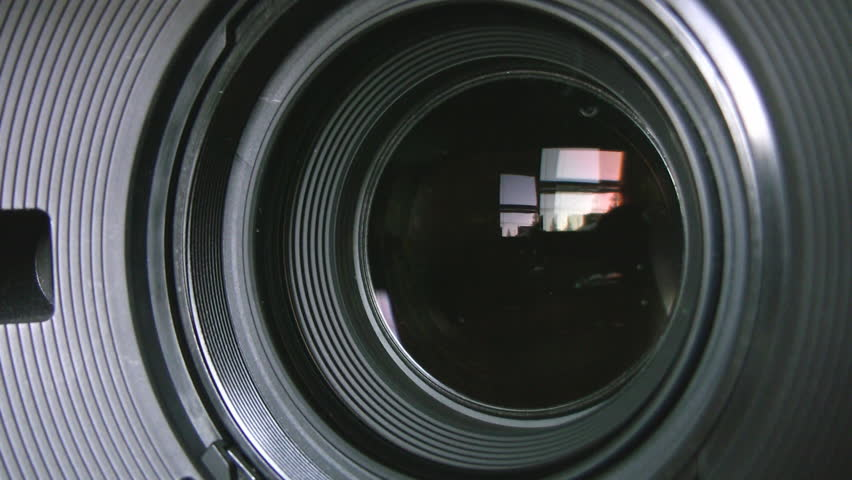 Camera zoom. Closeup shot of professional video camera, with its lens zooming in and out. Canon XH-A1s shot with a Canon HV30.