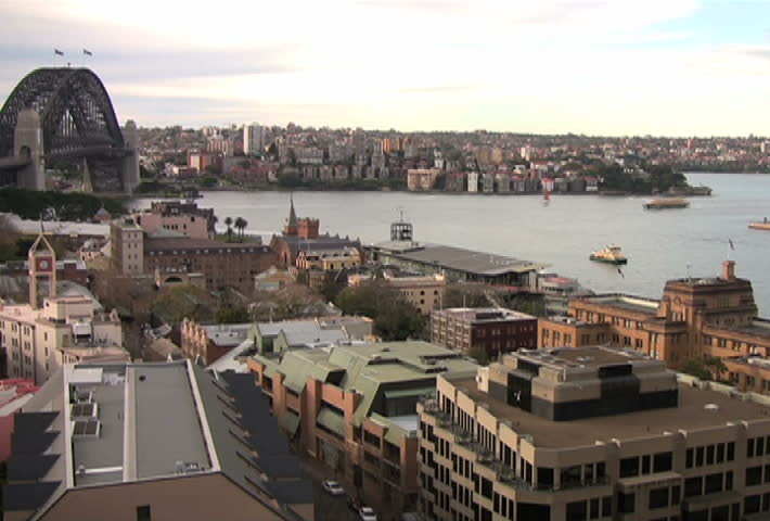 Aerial time lapse of boats passing through Sydney Harbor and Circular Quay