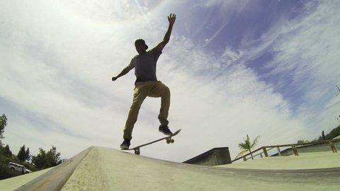 Slow Motion Extreme Skateboarder Grinds Down Rail