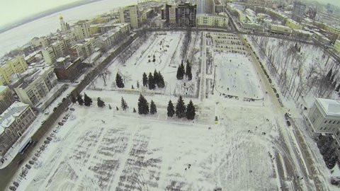 RUSSIA, SAMARA - JAN 6, 2014: Cityscape with skating rink on Kuibyshev Square at winter day. Aerial view