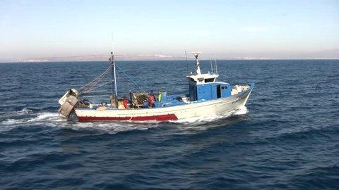 ALICANTE, SPAIN – JULY 3: Trawler boat finishing in open waters of Alicante coast; Spain; on July 3, 2014 in Alicante.