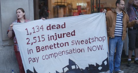 Demo outside Benetton in London - compensation for sweatshop disaster in Bangladesh, where garment factory collapsed killing 1,134 people and injuring over 2,500. June 18 2014, Oxford St, London.