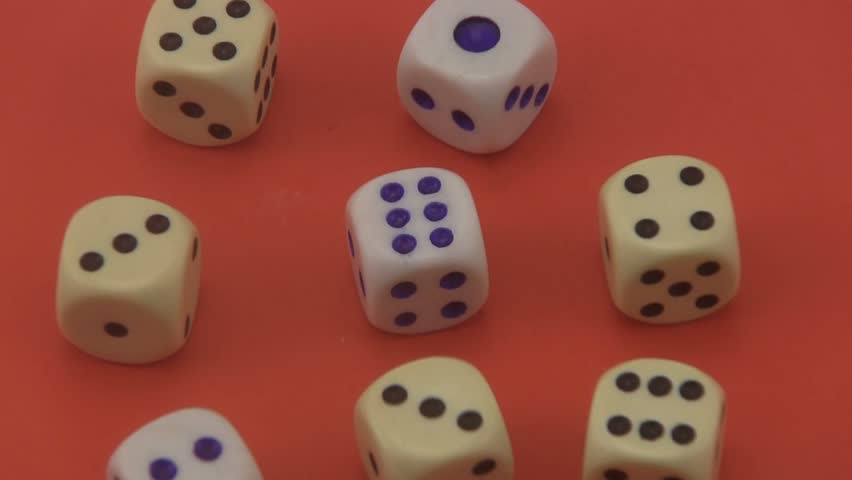 Dice that are used in board games and for gambling rotating on a red background. | Shutterstock HD Video #6757435