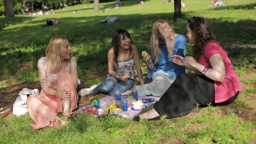 Cute Girls In The Park Having Picnic And Enjoying: Laughter ...