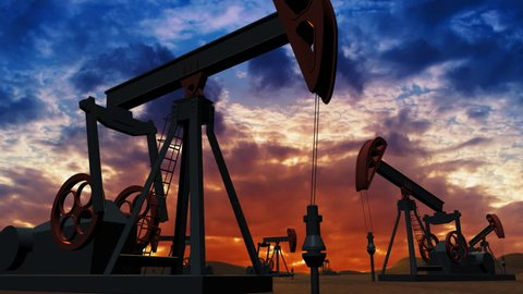 Oil pumps at sunset background