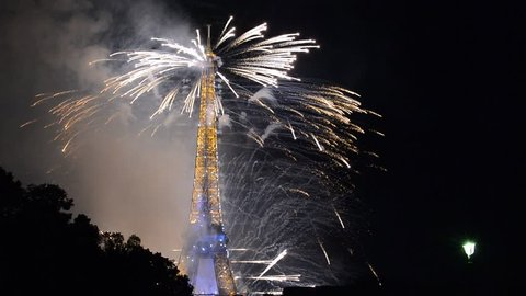 PARIS - JULY 14, 2014: Bastille Day fireworks at the Eiffel Tower. The 35-minute pyrotechnics display was designed to mark the centenary of World War One.