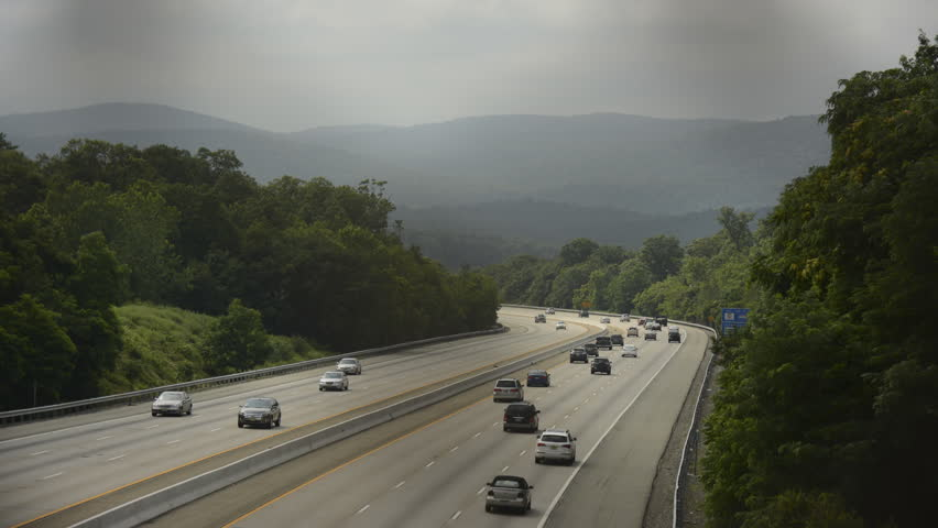 Highway traffic viewed from overpass time lapse 4K version. Route 287 in Wanaque New Jersey from the Cannonball Trail overpass. Cloudy with shadows.